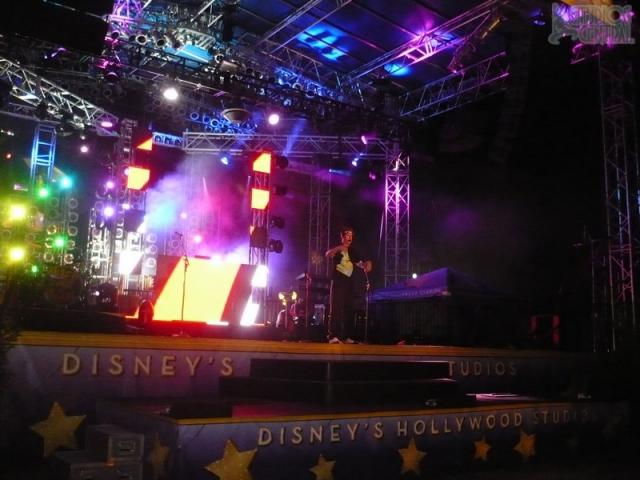 DJ entertaining guests at stage in front of Sorcerer's Hat