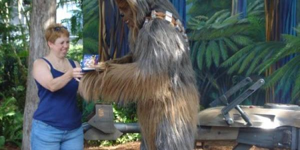 Chewbacca signs an autograph