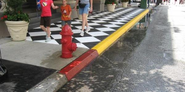 A fire hydrant on Streets of America is squirting water on any hot kids that walk by
