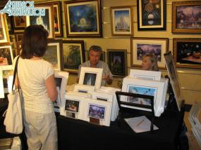 Larry Dotson displaying Christmas art for sale