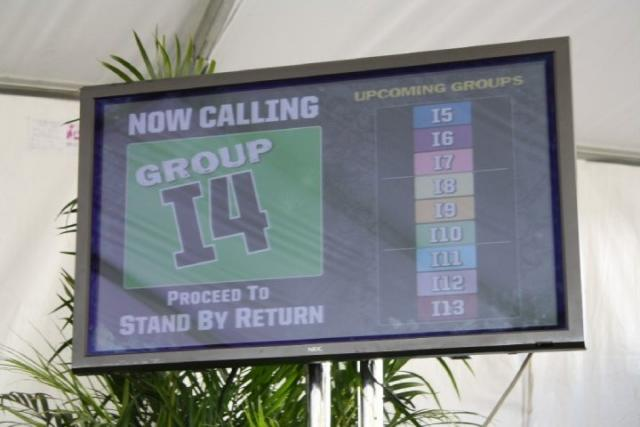 Video screen indicating which group can board